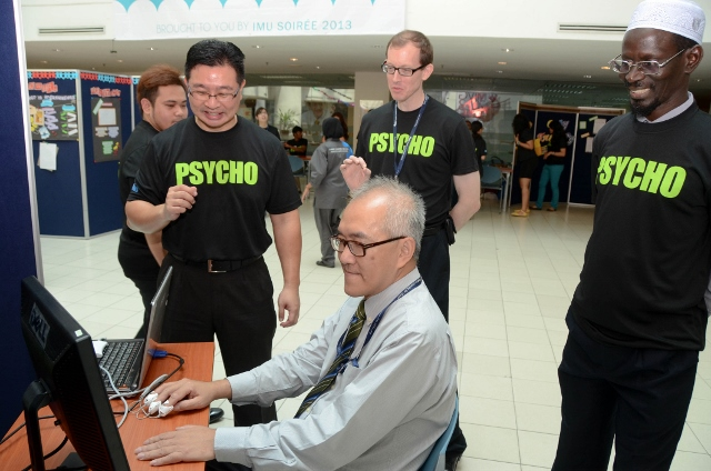 Prof Peter Pook being guided on the biofeedback device