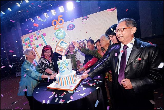 Cake cutting at IMU's 25th Anniversary Dinner