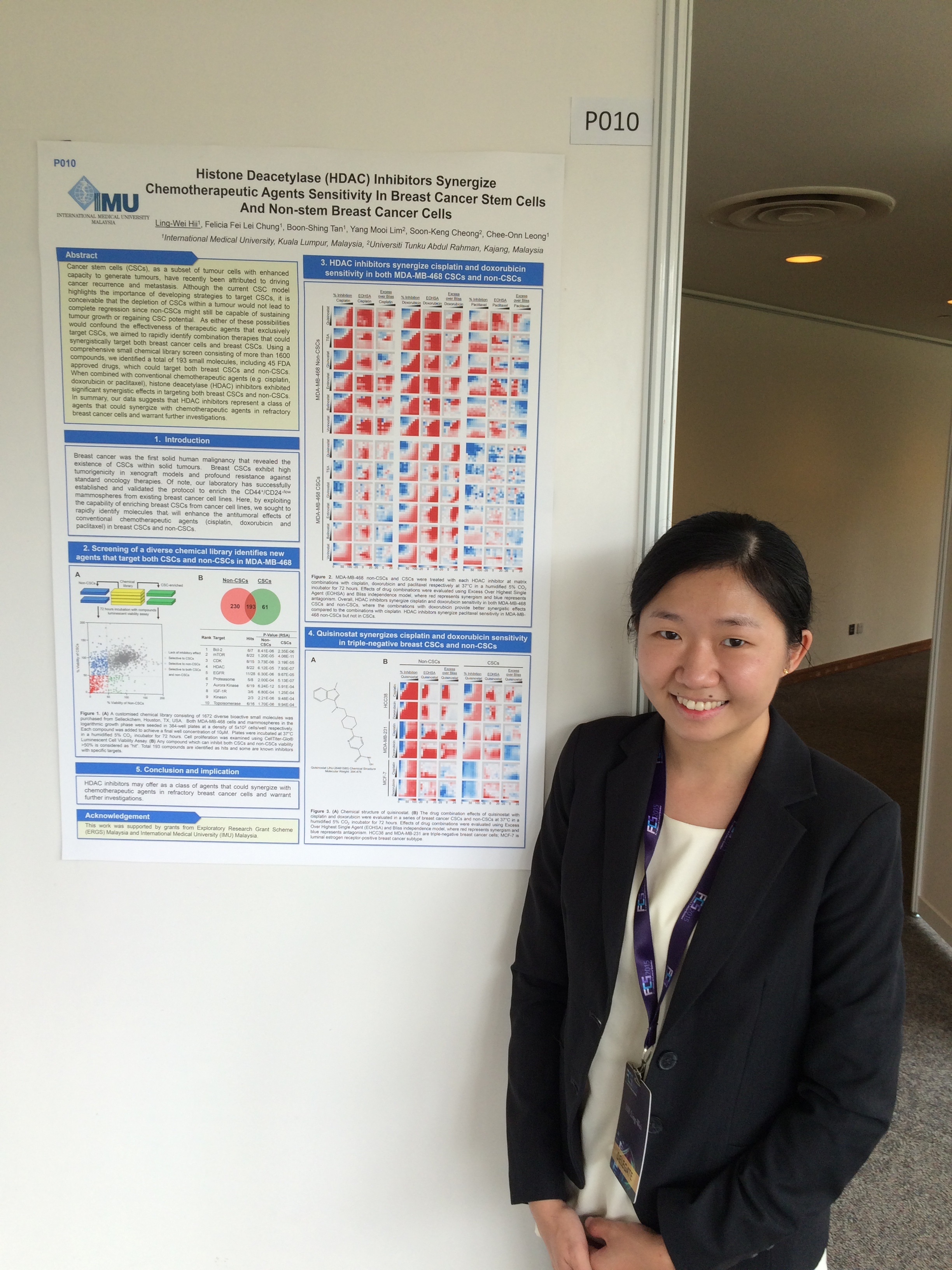 IMU Alumnus Ling Wei with her poster