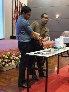 Anti-venom demonstration at a workshop attended by IMU students and their lecturer