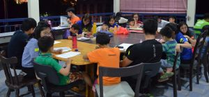 IMU student volunteers tutoring children at Rumah Charis